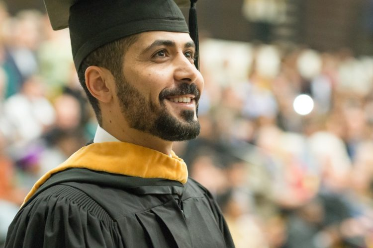 Man in graduation cap and gown