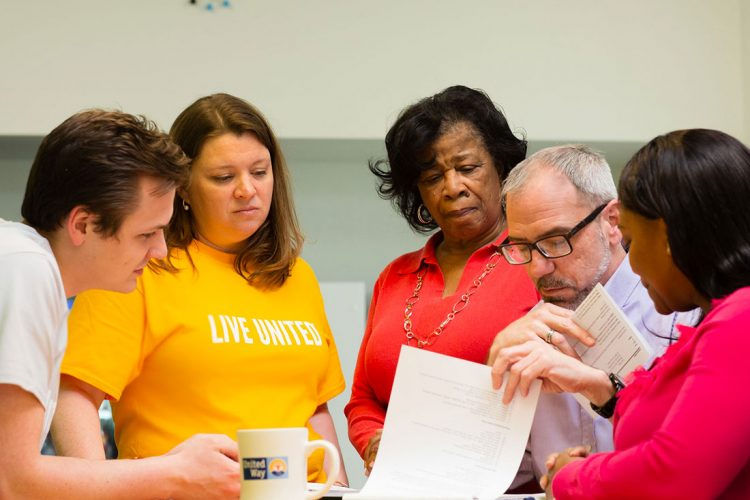 Group of United Way staff consulting in a group