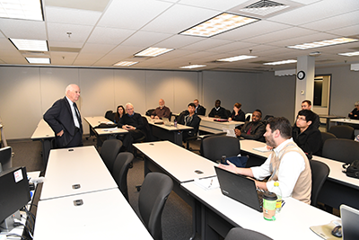Senator Ben Cardin speaks to an eager group of UMBC cybersecurity graduate students