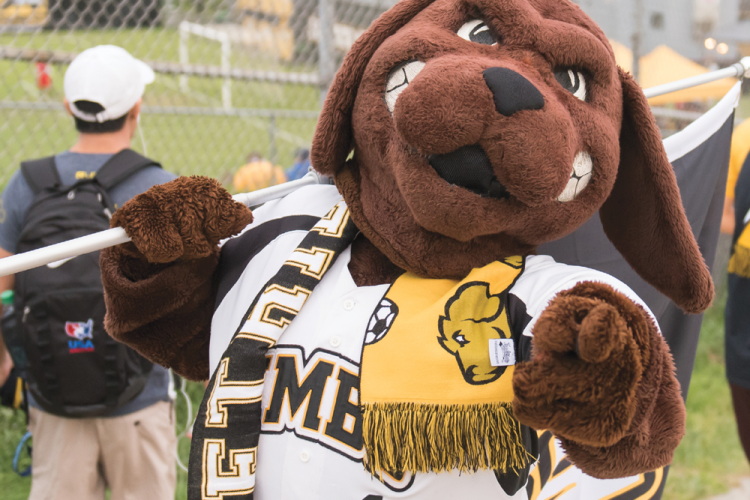 true grit mascot in the spirit of giving